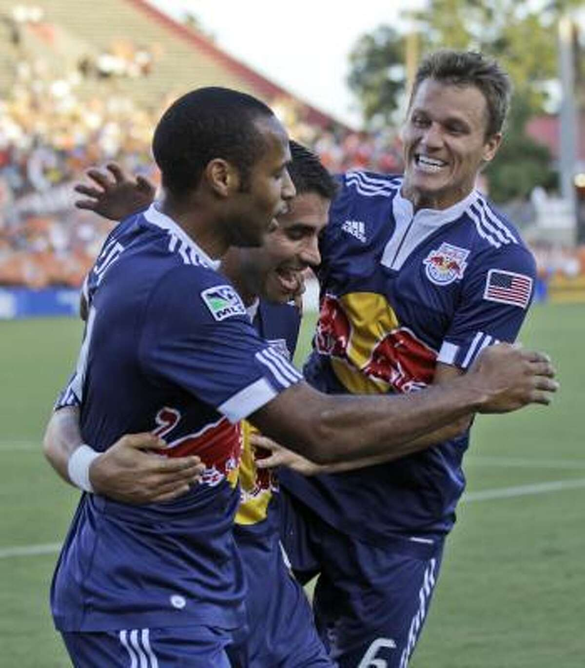 New York Red Bulls players, from left to right, Thierry Henry, Juan Pablo Angel and Seth Stammler celebrate Angel's goal on an assist by Henry during the ninth minute.