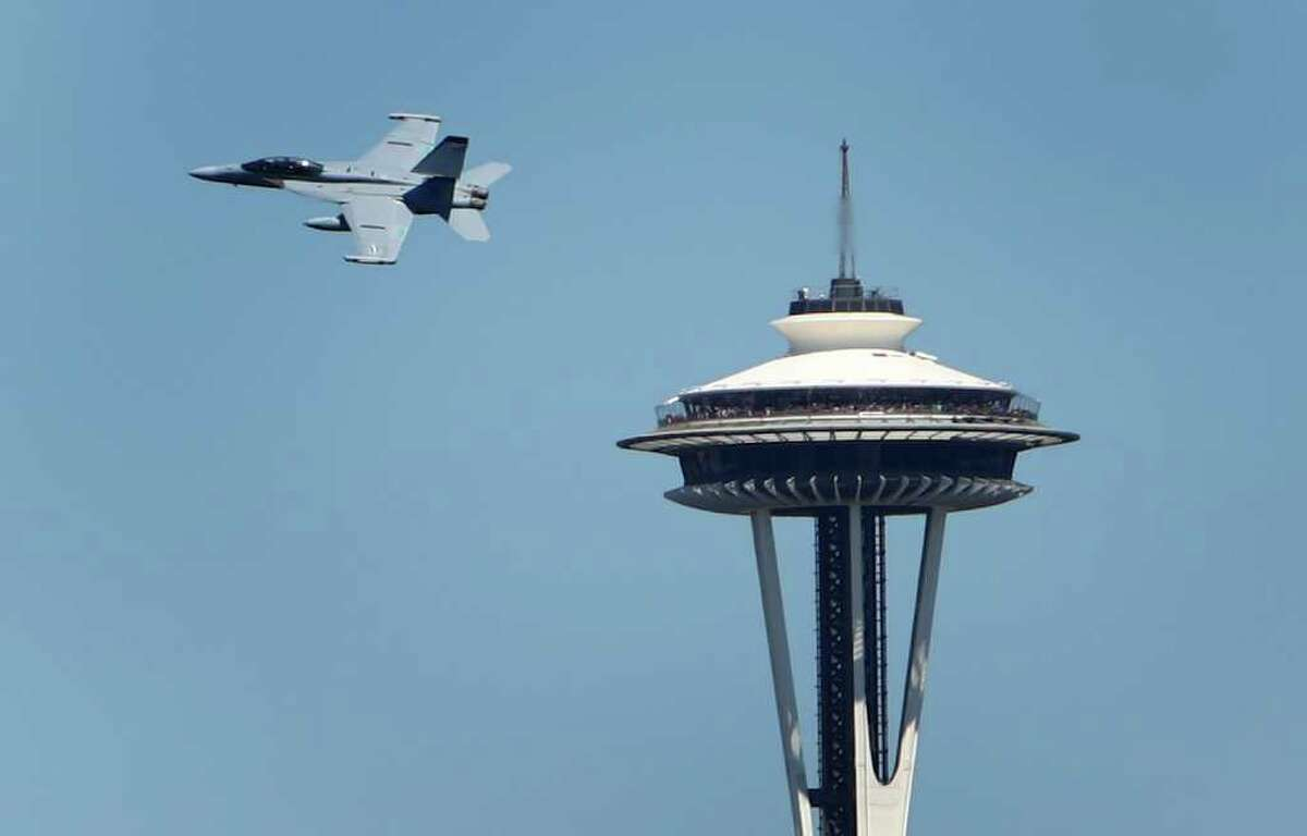 An EA-18G Growler passes the Space Needle during the Seafair Parade of Ships on Wednesday, August 3, 2011 on Puget Sound and along the Seattle waterfront.
