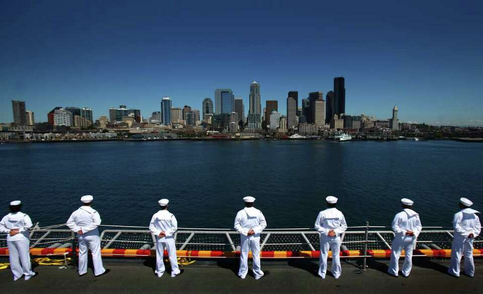 Sailors man the rails during the Seafair Parade of Ships on Wednesday, August 3, 2011 along the Seat