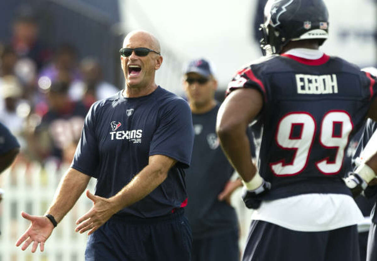Texans defensive line coach Bill Kollar works with his unit.