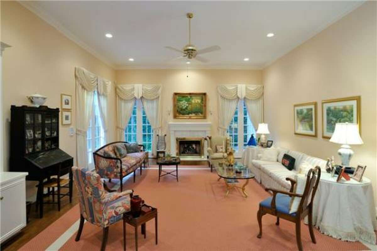 In addition to five bedrooms, this condo has a family room with fireplace and wet bar for $880,000. See more details and photos.