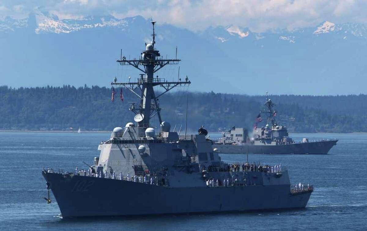 The USS Sampson is trailed by the USS Chaffee during the Seafair Parade of Ships on Wednesday, August 3, 2011 on Puget Sound and along the Seattle waterfront.