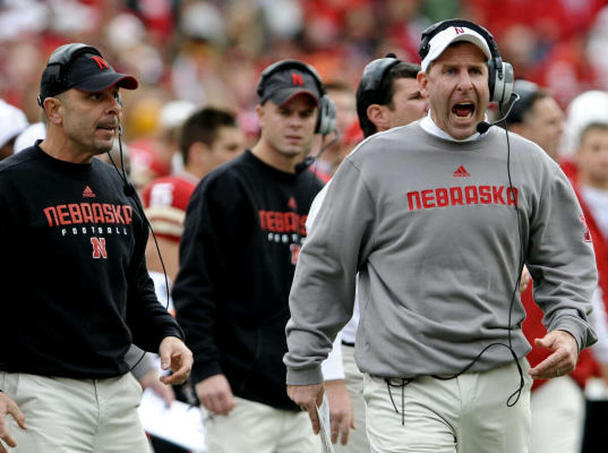 Both Nebraska head coach Bo Pelini, right, and defensive coordinator Carl Pelini, left, showed their emotions after Saturday's loss to Texas A&M.