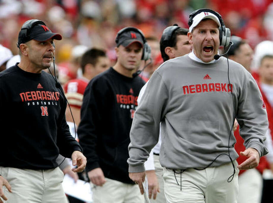 Both Nebraska head coach Bo Pelini, right, and defensive coordinator Carl Pelini, left, showed their emotions after Saturday's loss to Texas A&M. Photo: Dave Weaver, AP