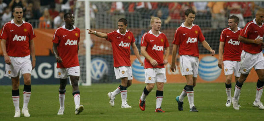 "Manchester United 5, MLS All-Stars 2Manchester United forward Javier ""El Chicharito"" Hernandez, center, celebrates with teammates after scoring his first goal for the club. Photo: Julio Cortez, Chronicle"