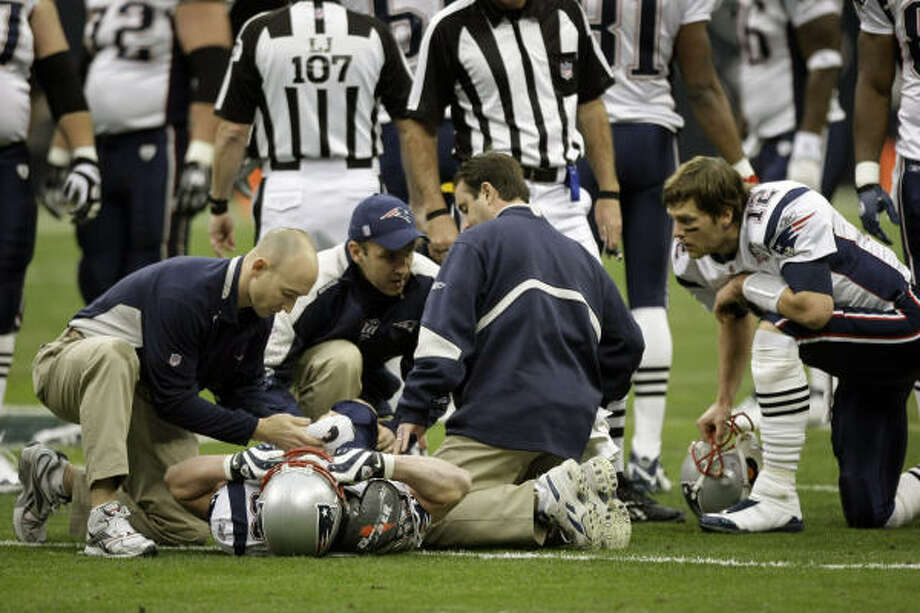 Patriots receiver Wes Welker cut sharply to avoid Texans safety Bernard Pollard and went down without being hit. Photo: Brett Coomer, Chronicle