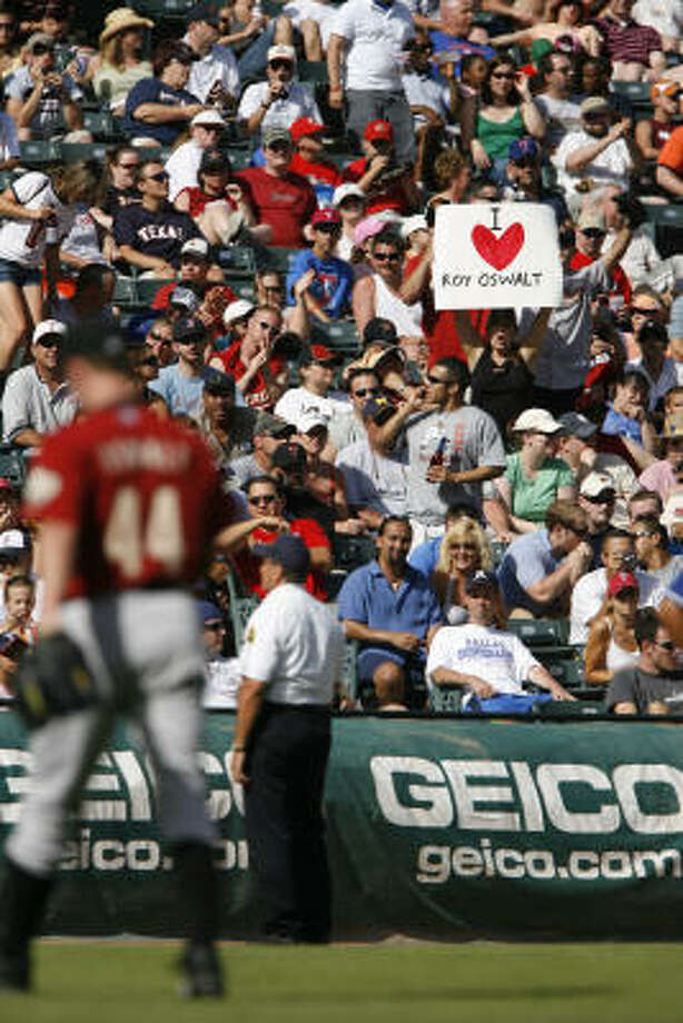 "A fan holds up an ""I love Roy Oswalt"" sign as the righthander  walks back to the dugout after being relieved during the seventh inning against the Texas Rangers in 2007. Photo: Karen Warren, Chronicle"