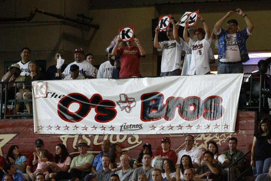 O's Bros, the fan club for Roy Oswalt, hold up their K's for one of the righthander's strikeouts. Photo: Karen Warren, Chronicle