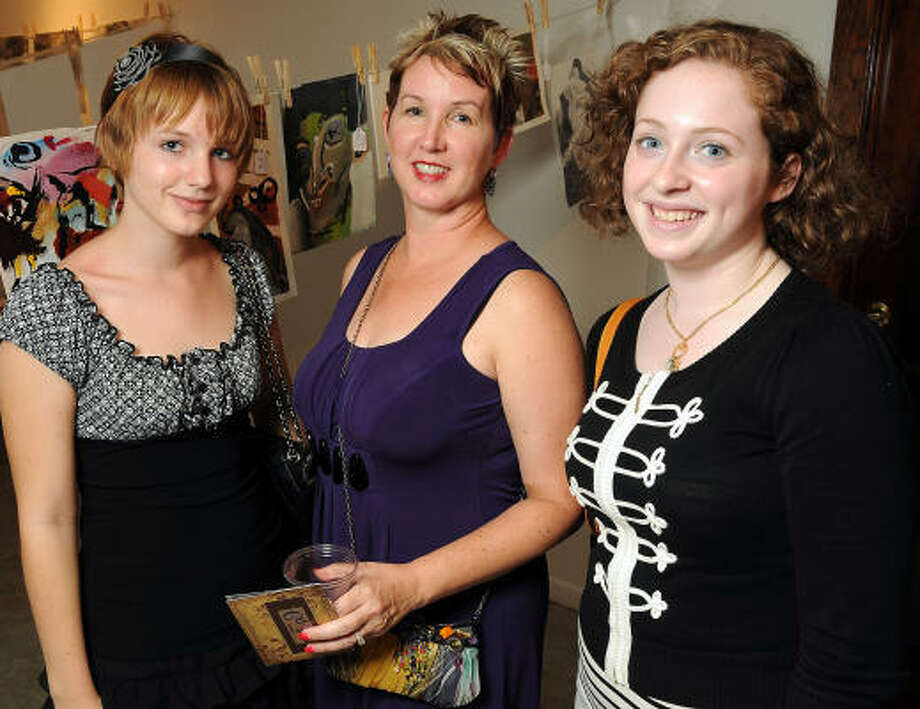 "From left: Marian Schwarz, Alice Quinn Schwarz and Bat-Sheva Tabakman at ""Strung Out,"" an indoor ""backyard party"" at Winter Street Studios. Photo: Dave Rossman, For The Chronicle"