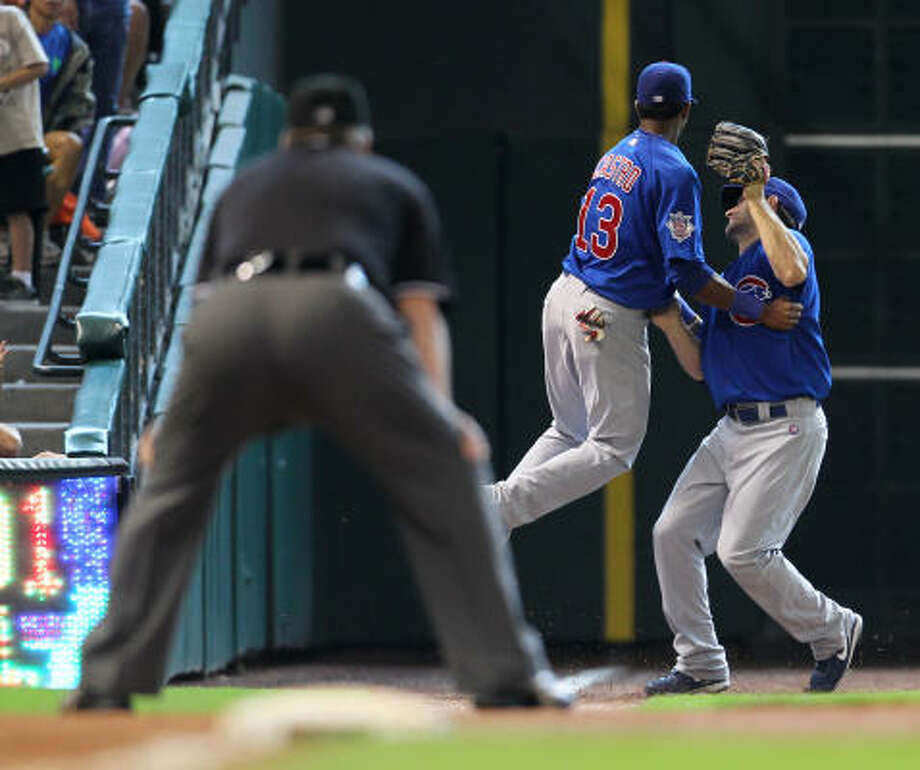 Cubs shortstop Starlin Castro (13) bounces away from outfielder Xavier Nady after the near collision. Photo: Karen Warren, Chronicle