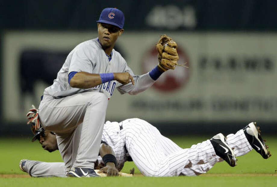 Jason Bourgeois, rear, steals second base safely as Cubs shortstop Starlin Castro makes the tag during the seventh inning. Bourgeois went on to score from third on a suicide squeeze bunt by Angel Sanchez. Photo: David J. Phillip, AP