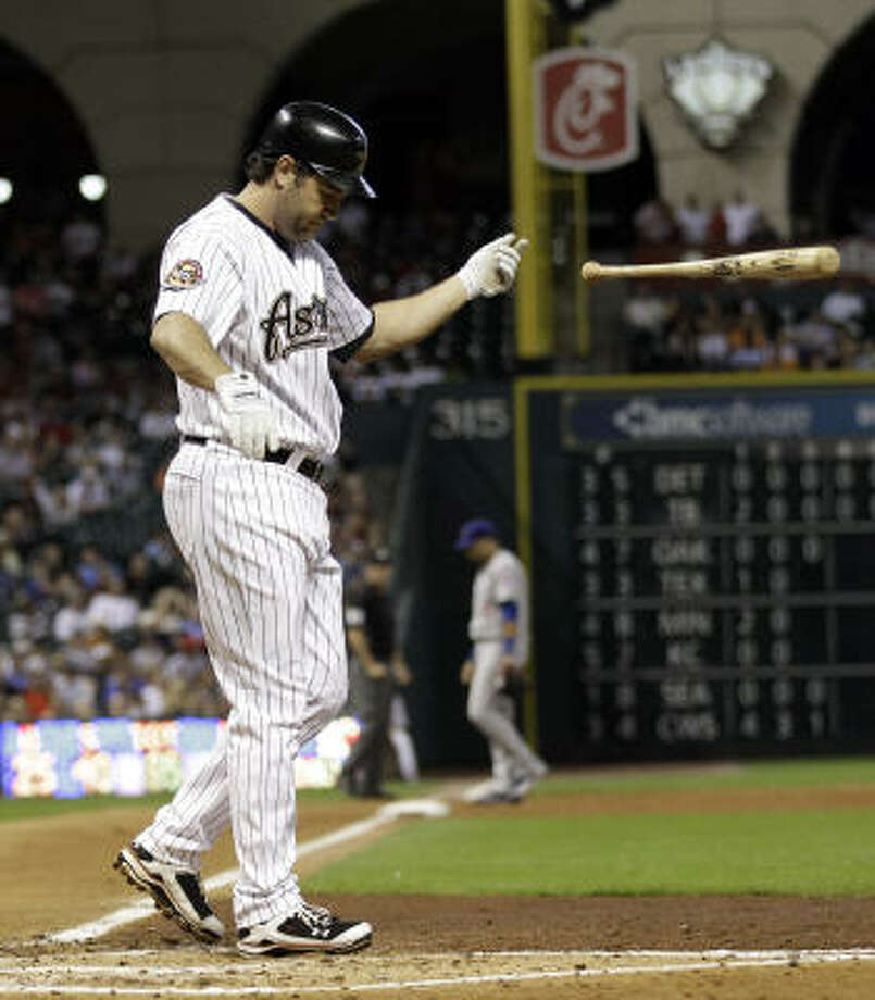 Lance Berkman tosses his bat after striking out to end the fourth inning. Photo: David J. Phillip, AP