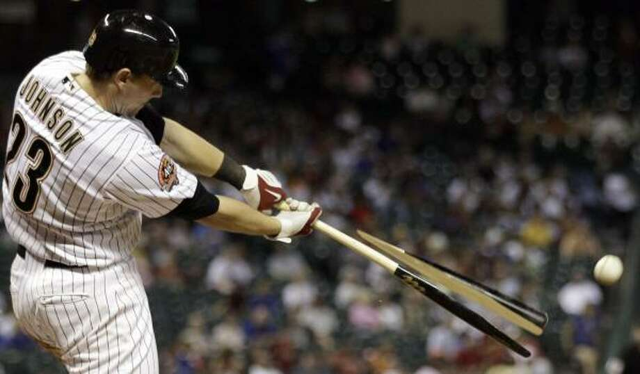 July 26: Cubs 5, Astros 2 Astros third baseman Chris Johnson breaks his bat as he hits a fly ball during the sixth inning. Photo: David J. Phillip, AP