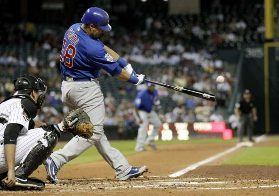 Cubs catcher Geovany Soto hits a two-run double as Astros catcher Jason Castro, left, reaches for the pitch during the second inning. Photo: David J. Phillip, AP