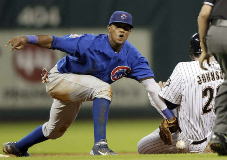 Astros third baseman Chris Johnson, right, steals second base safely as Cubs shortstop Starlin Castros, left, loses the ball during the second inning. Photo: David J. Phillip, AP