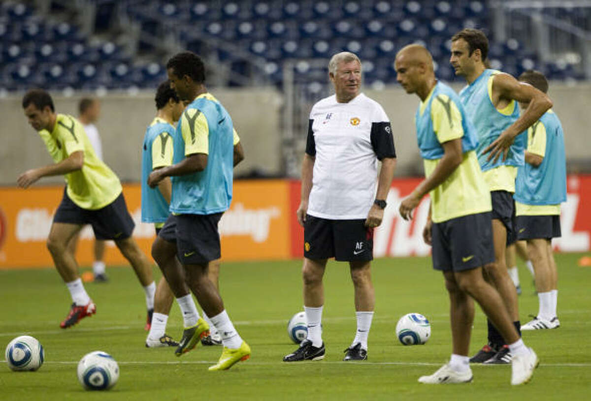 Manchester United manager Sir Alex Ferguson, center, directs his players in drills during a training session Tuesday at Reliant Stadium. Manchester United will take on the MLS All-Stars in an exhibition match Wednesday at Reliant Stadium.
