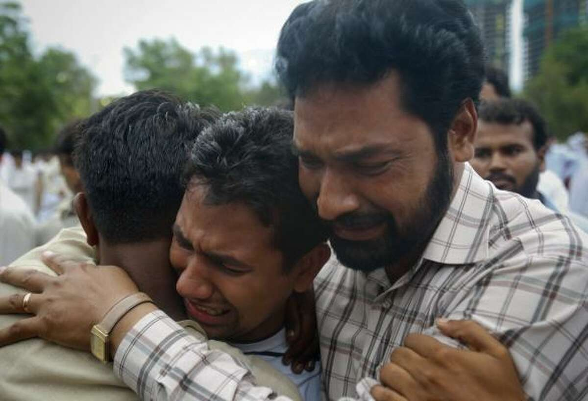 People mourn the deaths of their family members, reportedly killed in a plane crash, outside a local hospital in Islamabad, Pakistan on Wednesday, July 28, 2010. The passenger jet carrying 152 people crashed into the hills surrounding Pakistan's capital amid poor weather Wednesday, officials said.