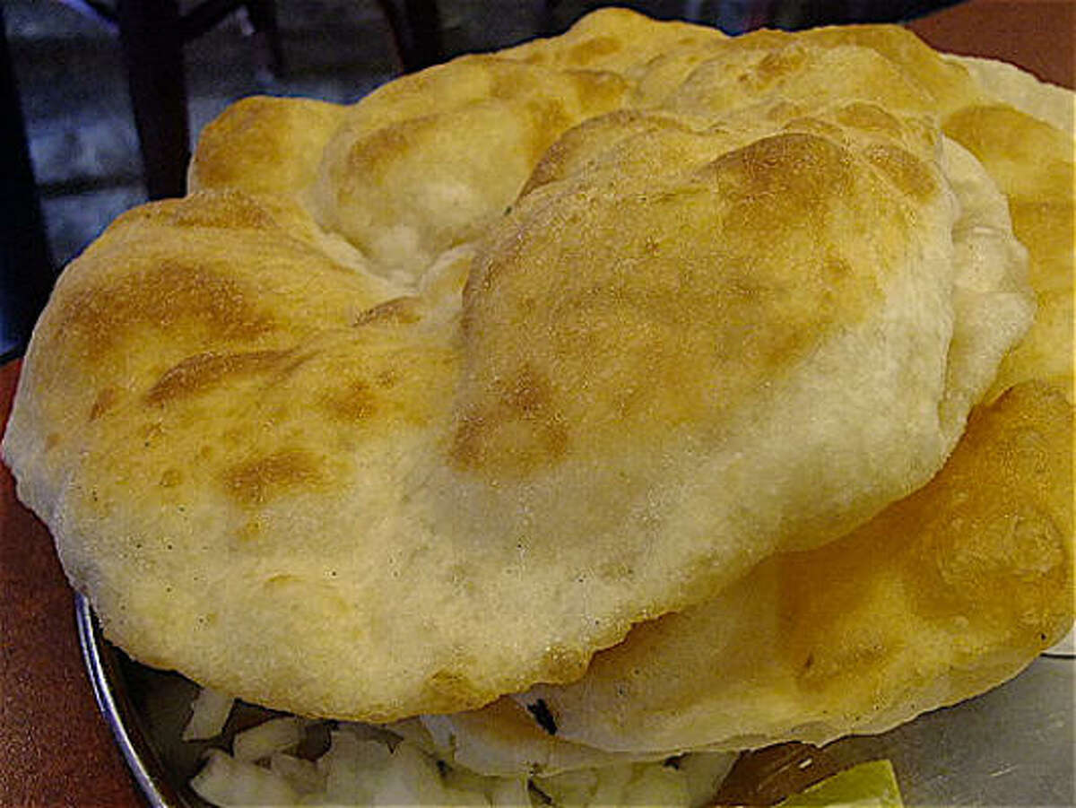 The puffed, fried wheat loaves called bhatura are as big as garden-party hats at Shri Balaji Bhavan on Hillcroft.