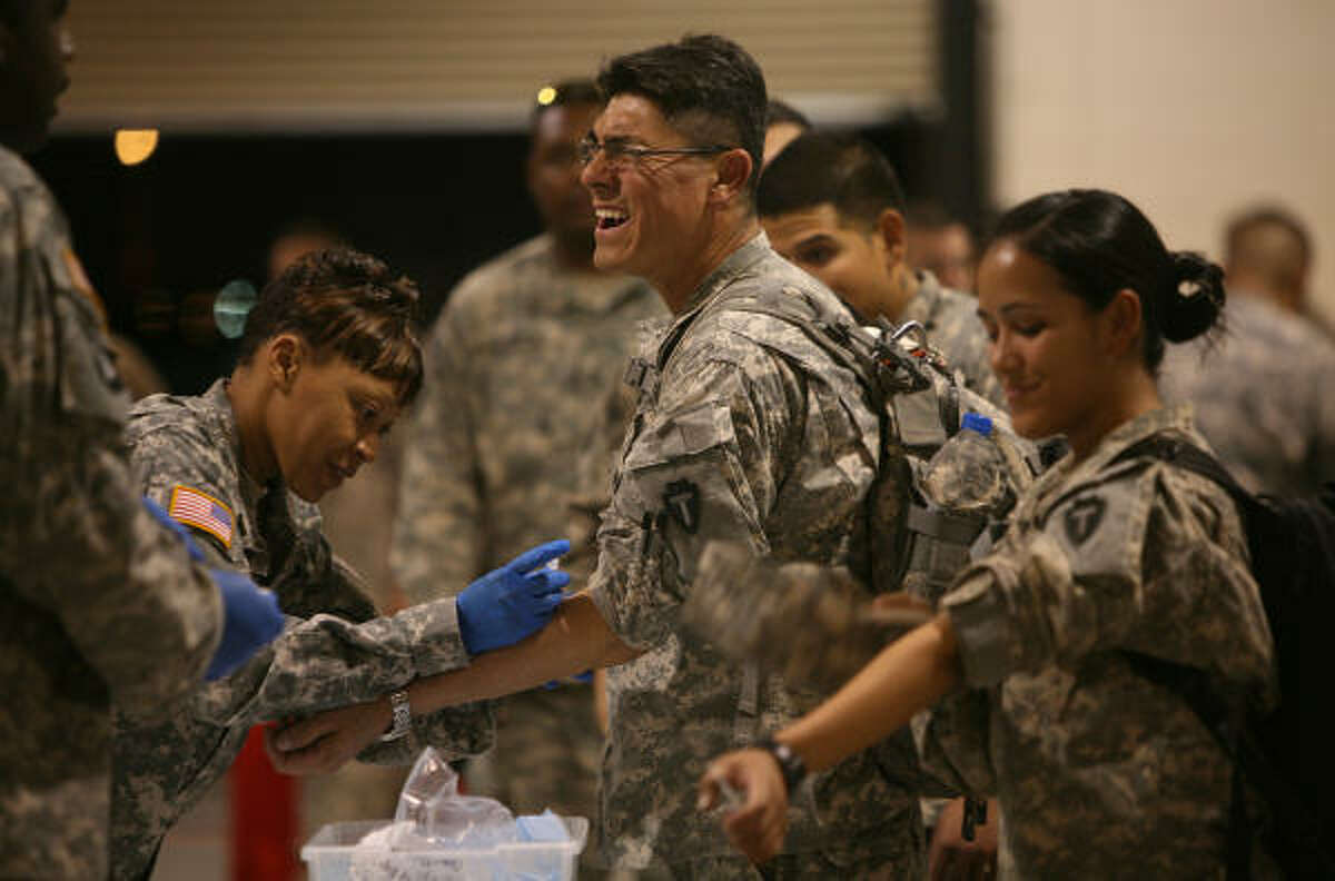 Sgt. Daniel Mendez, of Houston, with 72nd's IBCT Bravo-536, receives a TB test upon arrival to Biggs Army Airfield.