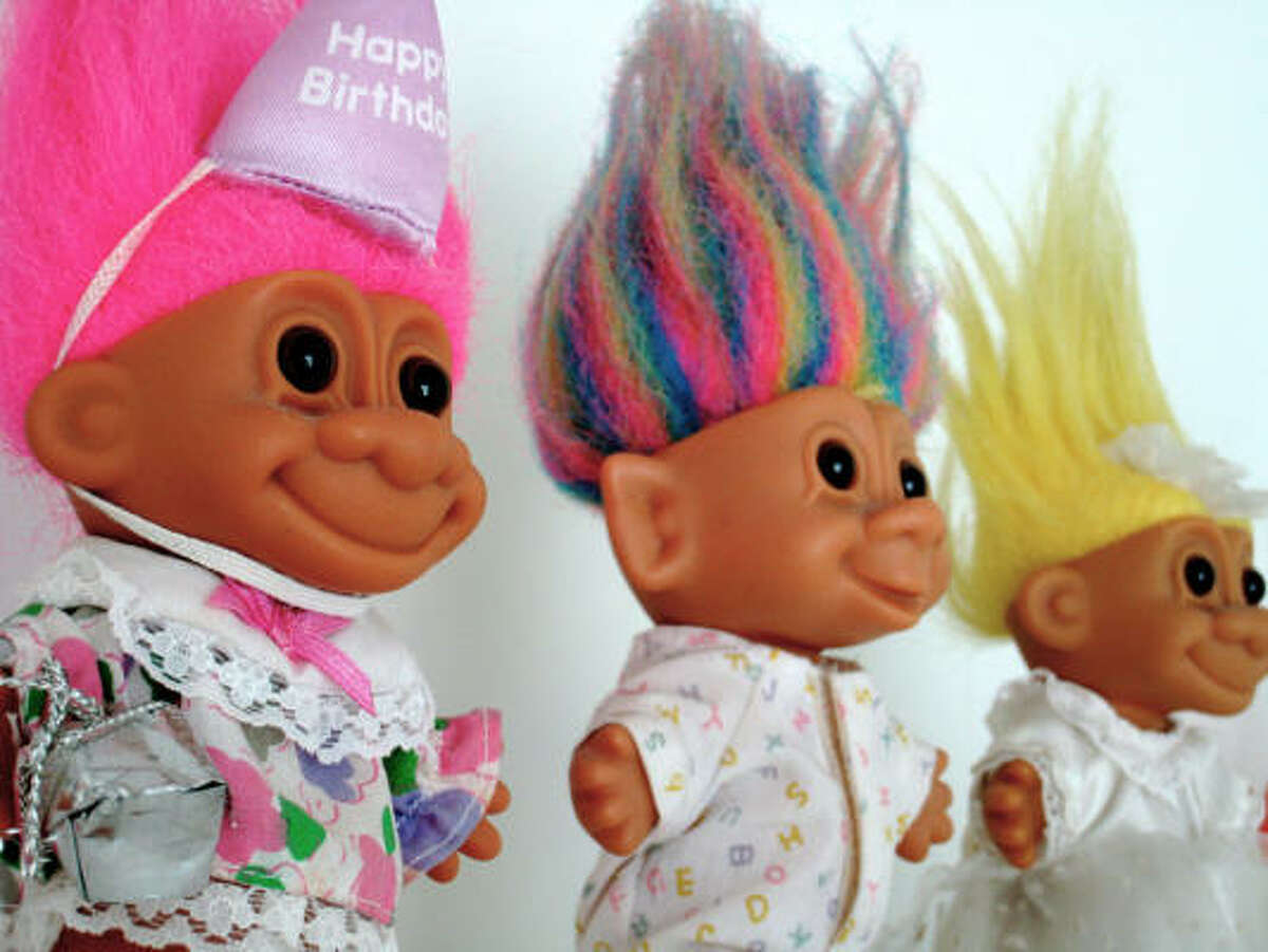 Trolls No matter how colorful their hair or how cute their outfits, those faces are ug-ly.