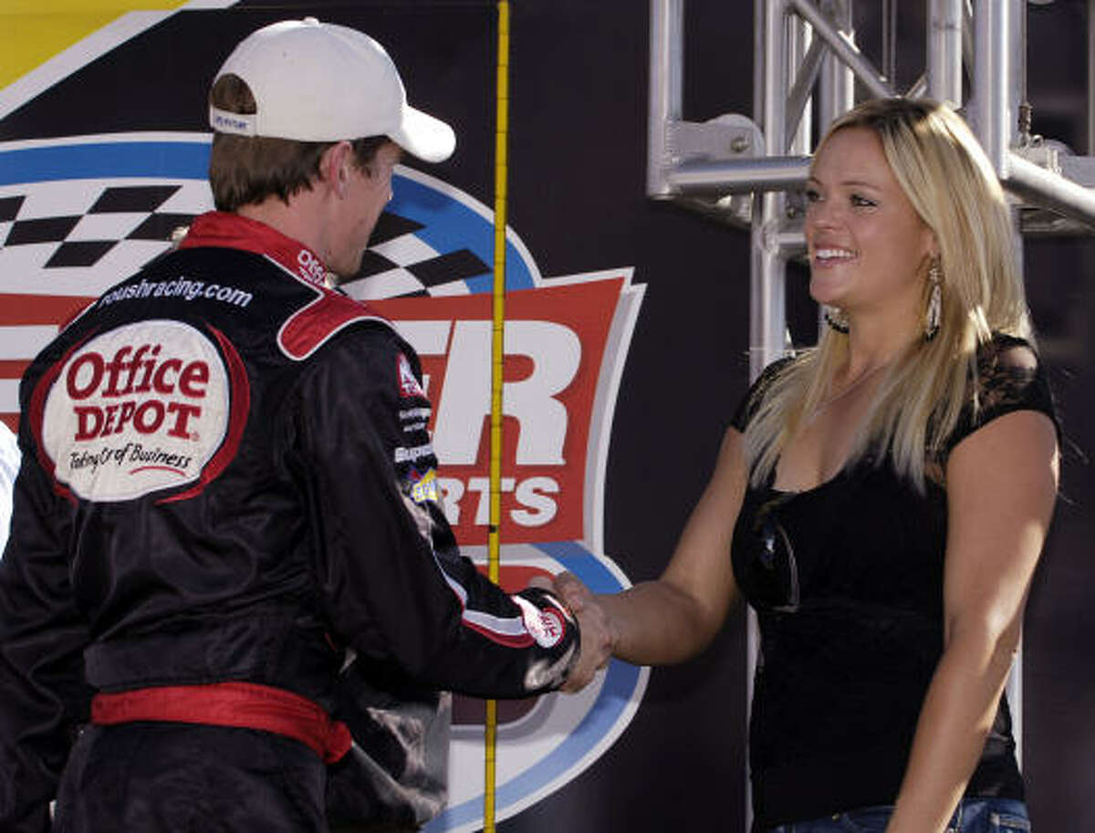 Greg Biffle, driver of the #16 National Guard/Post-it Ford, is greeted by Olympic softball standout Jennie Finch, during pre-race ceremonies for the NASCAR Nextel Cup Series Checker Auto Parts 500 in 2005.