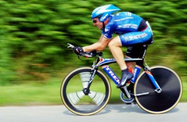 Lance Armstrong speeds along during the 9th stage of the 2002 Tour de France, which he won. Photo: Associated Press