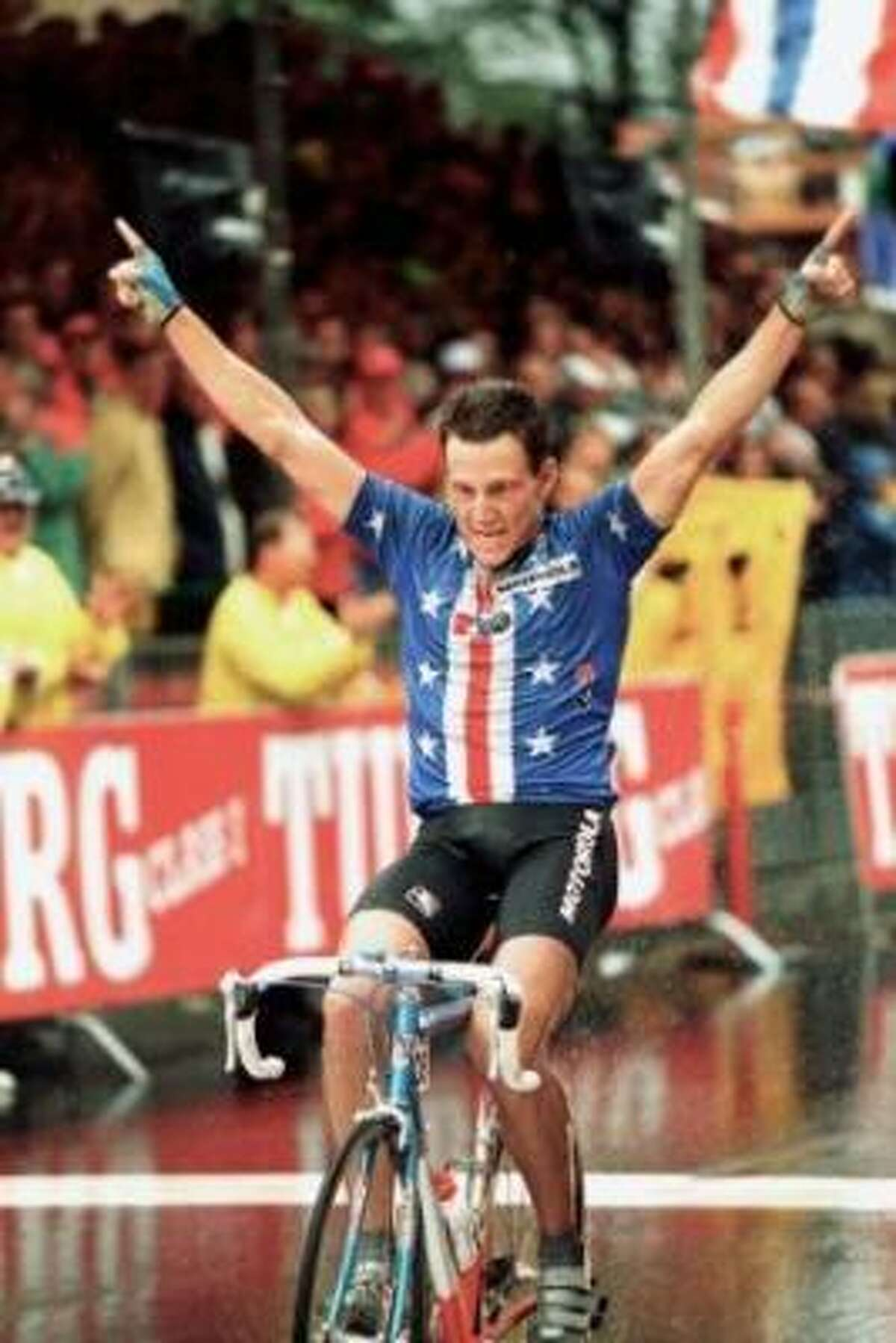 Lance Armstrong crosses the finish line to win the professional men's world championship road race in Oslo, Norway in 1993.