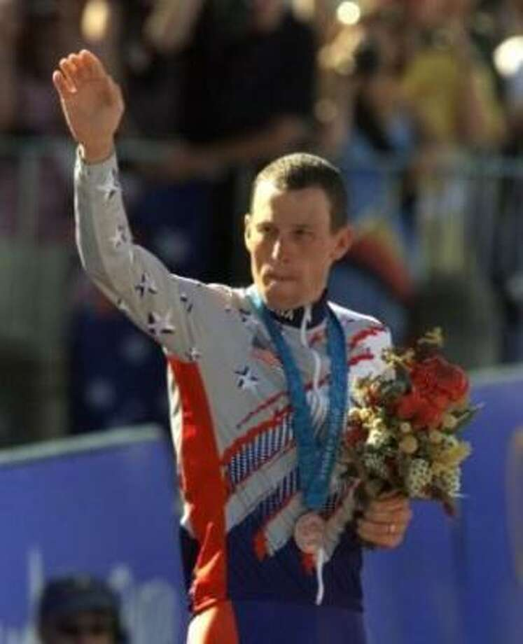 U.S. cyclist Lance Armstrong waves after receiving the bronze medal in the men's individual time trials during the 2000 Summer Olympics in Sydney, Australia. Photo: Associated Press