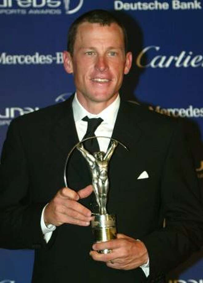 US cycle champion Lance Armstrong poses with the Laureus World Sportsman of the year award, during The 2003 Laureus World Sports Awards ceremony in Monaco. The Laureus World Sports Awards ceremony honors each year's sporting heroes. Photo: LIONEL CIRONNEAU, AP