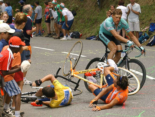 Lance Armstrong, left, crashes with Iban Mayo of Spain in the final ascent towards Luz-Ardiden, during the 15th stage of the 2003 Tour de France. Photo: BERNARD PAPON, AP