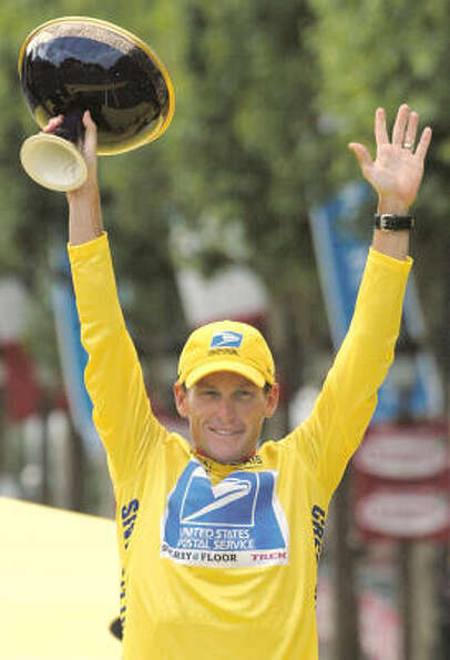 Lance Armstrong holds the winner's trophy from the podium after winning his fifth consecutive Tour d
