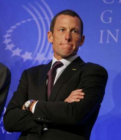 In 2008, cyclist Lance Armstrong holds a news conference during the Clinton Global Initiative annual meeting in New York to discuss whether a French newspaper was right when it reported that he used a banned drug. Photo: Jason DeCrow, AP