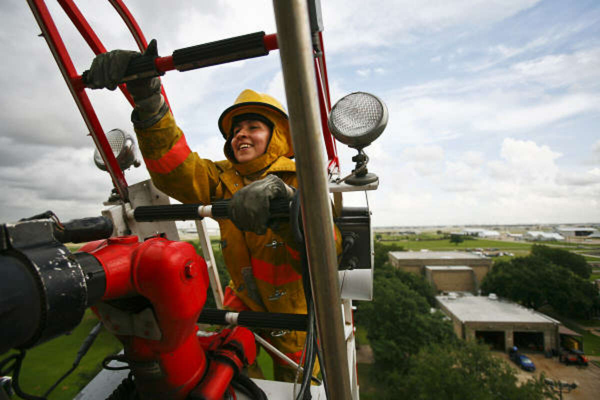 Paula Fletscher makes it to the top of an 80-foot ladder during a firefighting exercise for 30 firefighters from Latin America and the Caribbean who are in town this week to attend a class on Basic Fire Suppression at the Val Jahnke Training Facility in Houston. Firefighters from Peru, Colombia, Chile, Argentina and the Dominican Republic are visiting Houston until Friday to attend the 40-hour Basic Fire Suppression class. These Firefighters will be instructed by members of the Houston Fire Department at the Val Jahnke Training Facility on topics like ventilation, RIT (Rapid Intervention Team), the use of SCBA gear and others.
