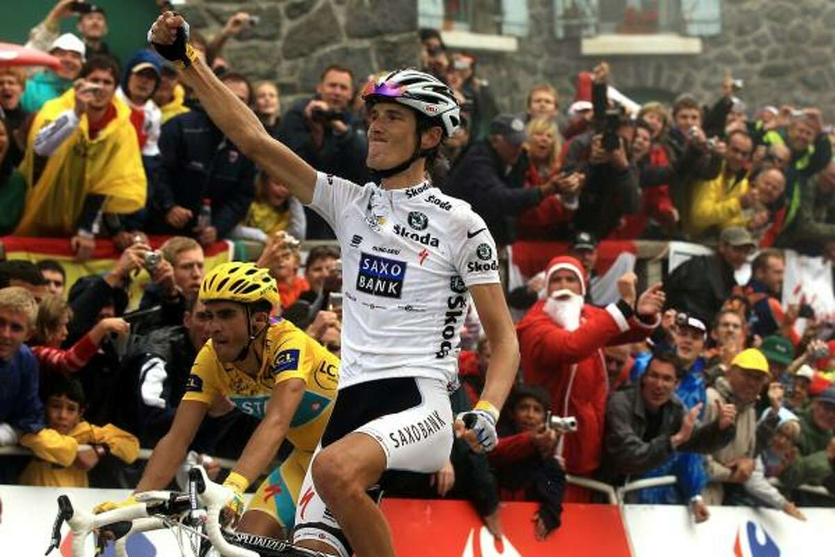 Andy Schleck won the prestigious stage but Alberto Contador crossed the line nearly shoulder to shoulder with the Luxembourg rider after the pair had broken clear in the final six miles.