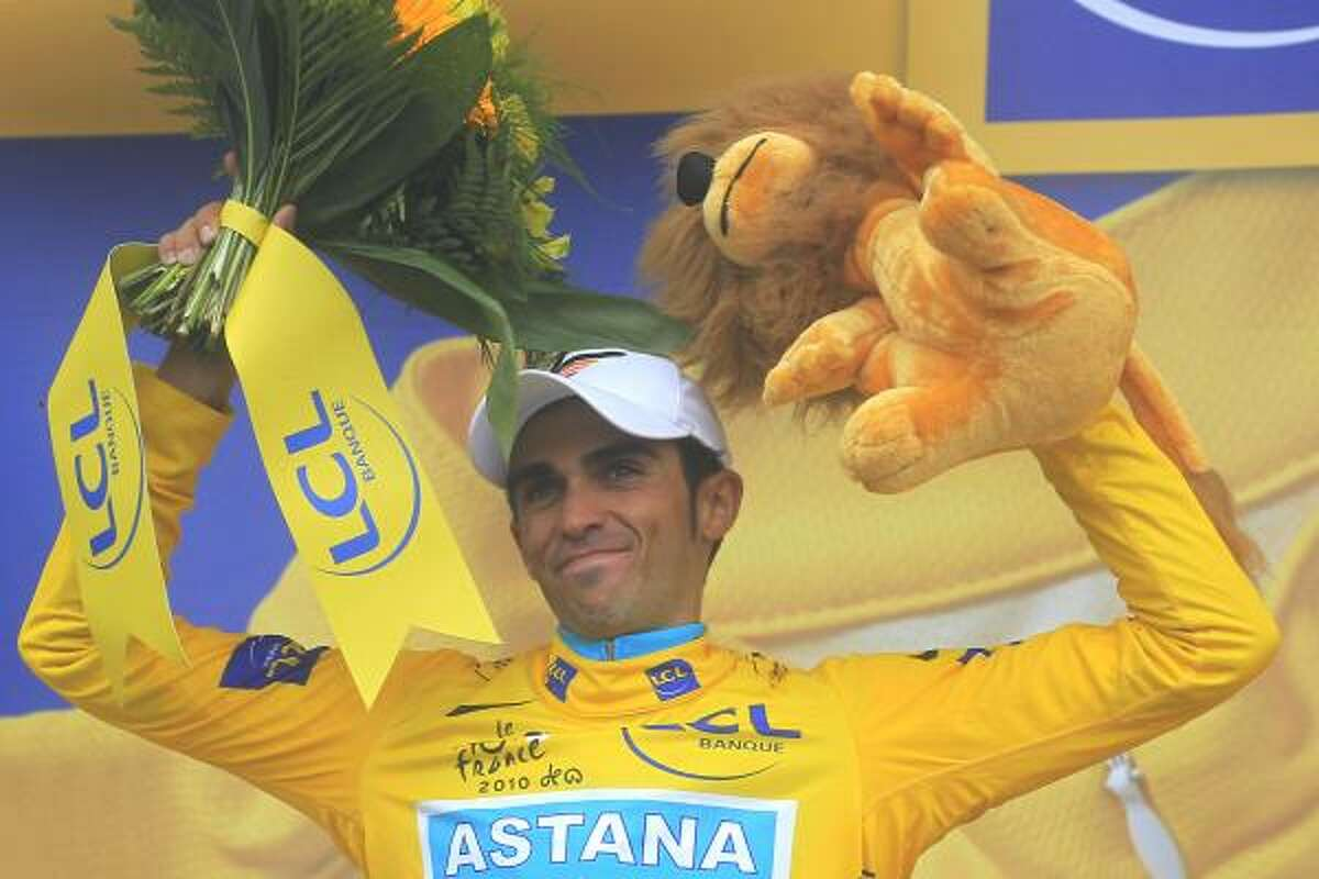 Defending champion Alberto Contador of Spain virtually secured a third Tour de France title Thursday after staying with yellow-jersey rival Andy Schleck all the way to the top of the legendary Col du Tourmalet in the pivotal 17th stage.