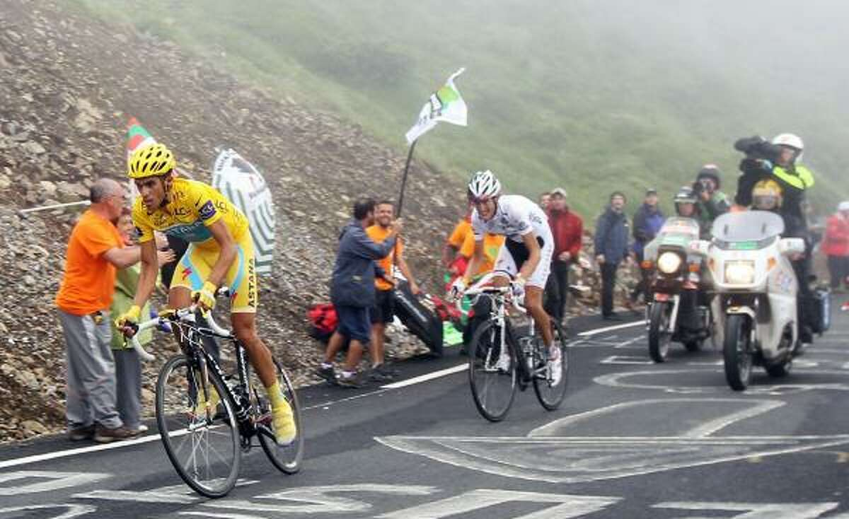 Alberto Contador leads Andy Schleck as he attacks up the slopes of the Col du Tourmalet during Stage 17.