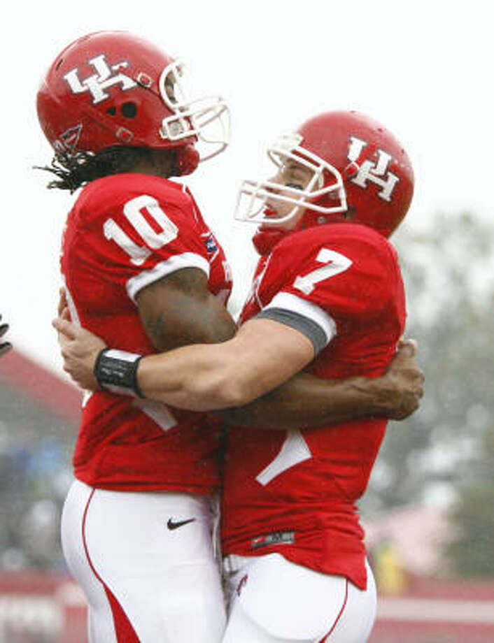 Houston wide receiver L.J. Castile (10), left, gets a hug from Case Keenum after scoring a touchdown in the first quarter of his game against the University of Memphis Saturday, Nov. 21, 2009, in Robertson Stadium in Houston. ( Nick de la Torre / Chronicle ) Photo: Nick De La Torre, Houston Chronicle