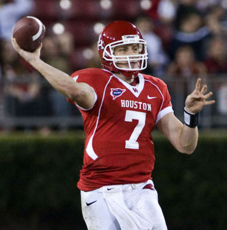Houston quarterback Case Keenum passes during the third quarter of their NCAA football game against Tulane Saturday, Nov. 8, 2008 in Houston. Keenum passed for 384 yards and four touchdowns to lead Houston to a 42-14 win over Tulane. Photo: Dave Einsel, AP