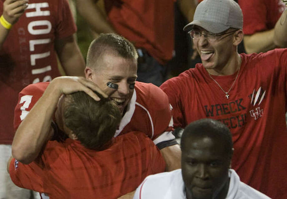 Houston quarterback Case Keenum (7) celebrates by hugging his father following the Cougars 29-28 victory over Texas Tech in college football action at Robertston Stadium Sunday, Sept. 27, 2009, in Houston. Photo: Smiley N. Pool, Houston Chronicle