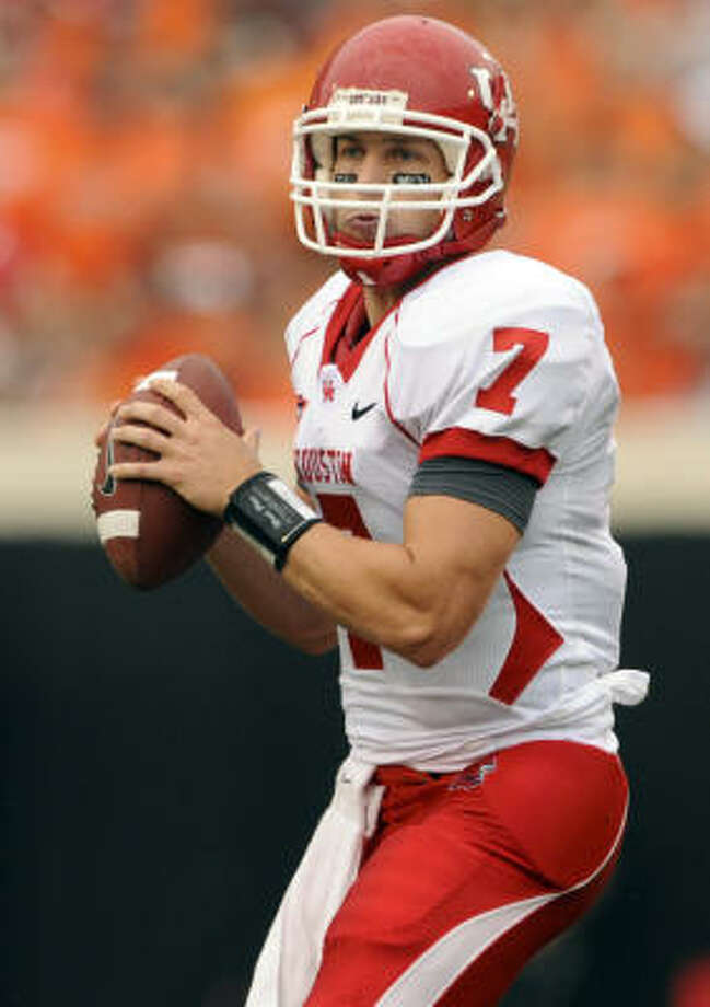 In this photo taken on Saturday, Sept. 12, 2009, Houston quarterback Case Keenum looks down field during the first half of an NCAA college football game against Oklahoma State in Stillwater, Okla. The Cougars busted into the AP top 25 poll by knocking off then-No. 5 Oklahoma State 45-35 and moved up after a bye week in which several ranked teams lost. Photo: Brody Schmidt, AP