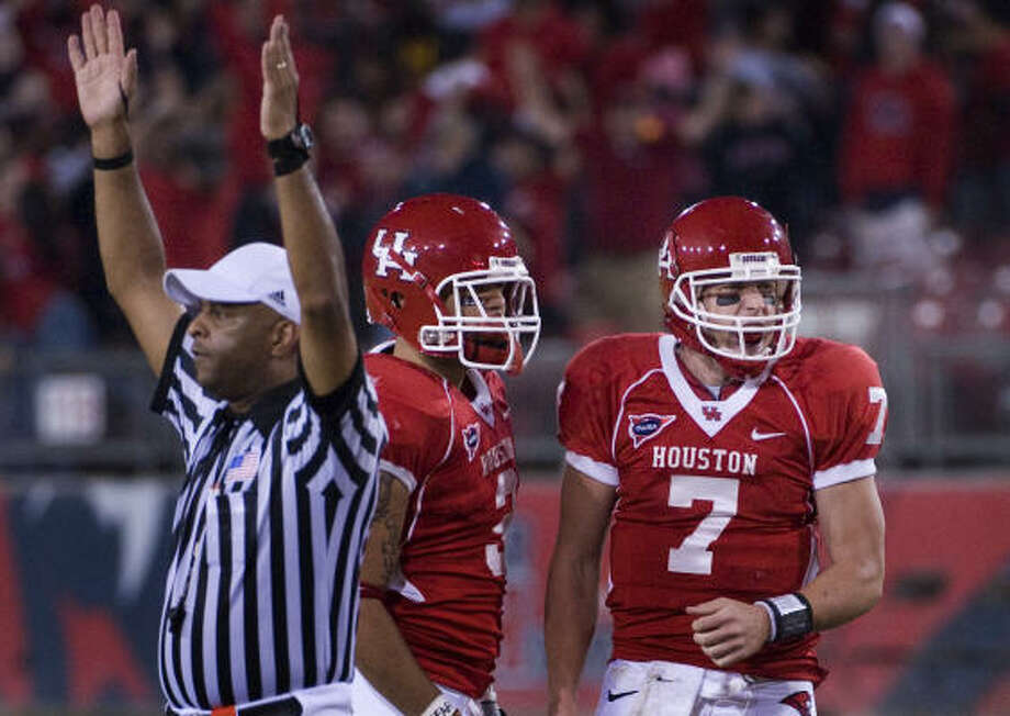 Houston quarterback Case Keenum (7) and Justin Johnson (3) celebrate after Keenum connected with wide receiver Kierrie Johnson for a touchdown that game the Cougars their first lead of the game with 4:54 left in the fourth quarter of the Cougars 42-37 victory over UTEP in a college football game at Robertson Stadium,  Saturday, Nov. 22, 2008, in Houston. Photo: Smiley N. Pool, Houston Chronicle
