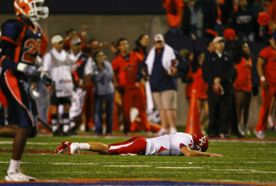 Houston quarterback Case Keenum (7) collapses on the turf after his fumbled  snap was returned 70-yards by UTEP linebacker Roddray Walker for a touchdown during the Miners 58-41 upset at the Sun Bowl Saturday, Oct. 3, 2009, in El Paso. ( Smiley N. Pool / Chronicle ) Photo: Smiley N. Pool, Houston Chronicle