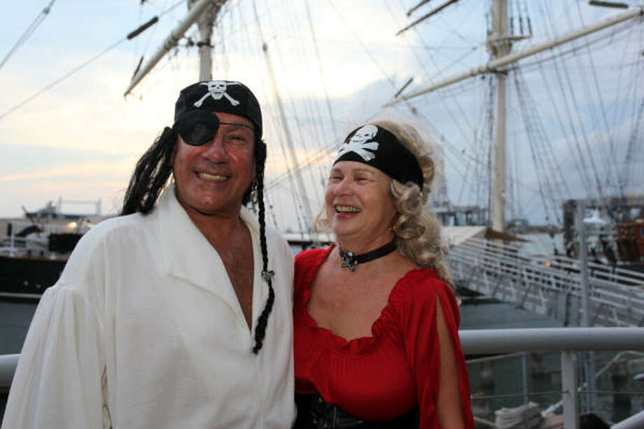 From left: Art Vega and Val at the Galveston Arts Center's Third Annual Swashbuckler's Soiree at the Texas Seaport Museum. Photo: Holly Dutton, For The Chronicle