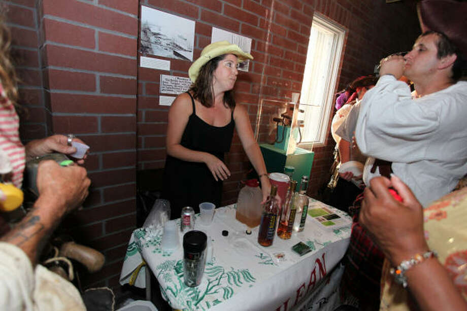 Kelly Railean, center, founder of Railean Rum, hands out samples in this file photo. Railean set up her distillery in the Houston-Galveston area in 2006 with the vision of re-establishing the American rum industry. Though known for rum making, Railean has branched out to Agave spirits as well. Tours are available but by appointment only. Photo: Holly Dutton