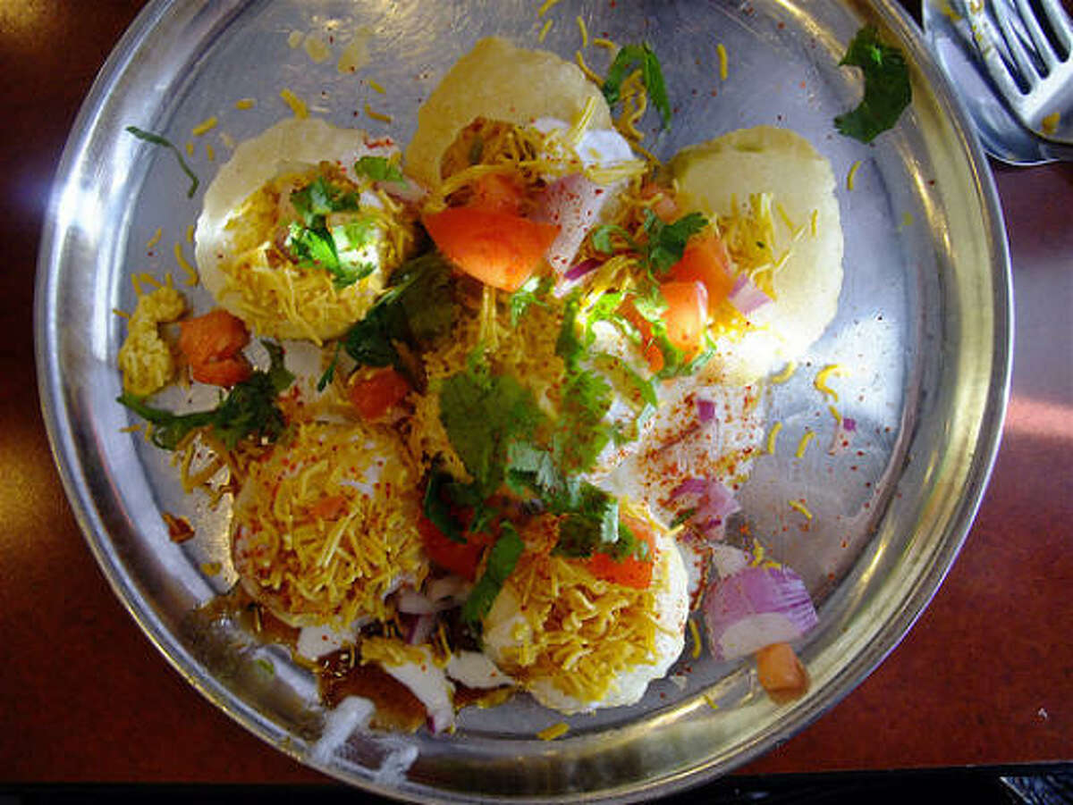 Dahi puri at Balaji Bhavan. The traditional way to eat puri is to pop a whole one in your mouth, the better to experience all the flavors and textures at once. It's tricky, though. Good luck.