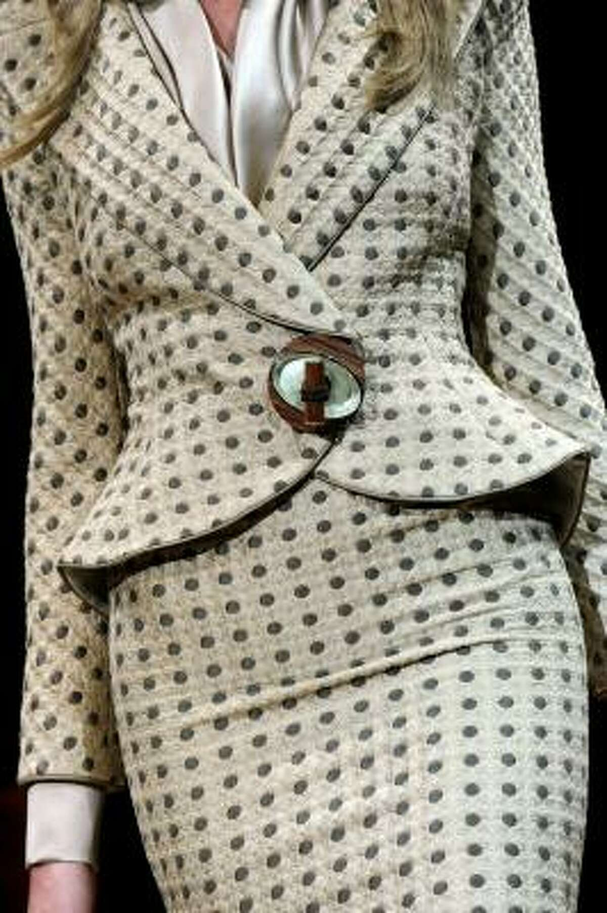 But Mod wasn't the only fashion statement of the '60s. Throwbacks to '50s apparel were still very prominent in 1964. This outfit detail is from the Giorgio Armani Prive shown July 6, 2010.