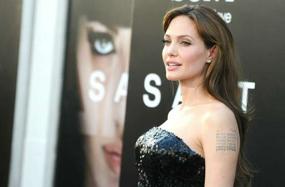 "Leading star of the film Angelina Jolie arrives at the premiere of Sony Pictures' ""Salt."" Photo: Jason Merritt, Getty Images"