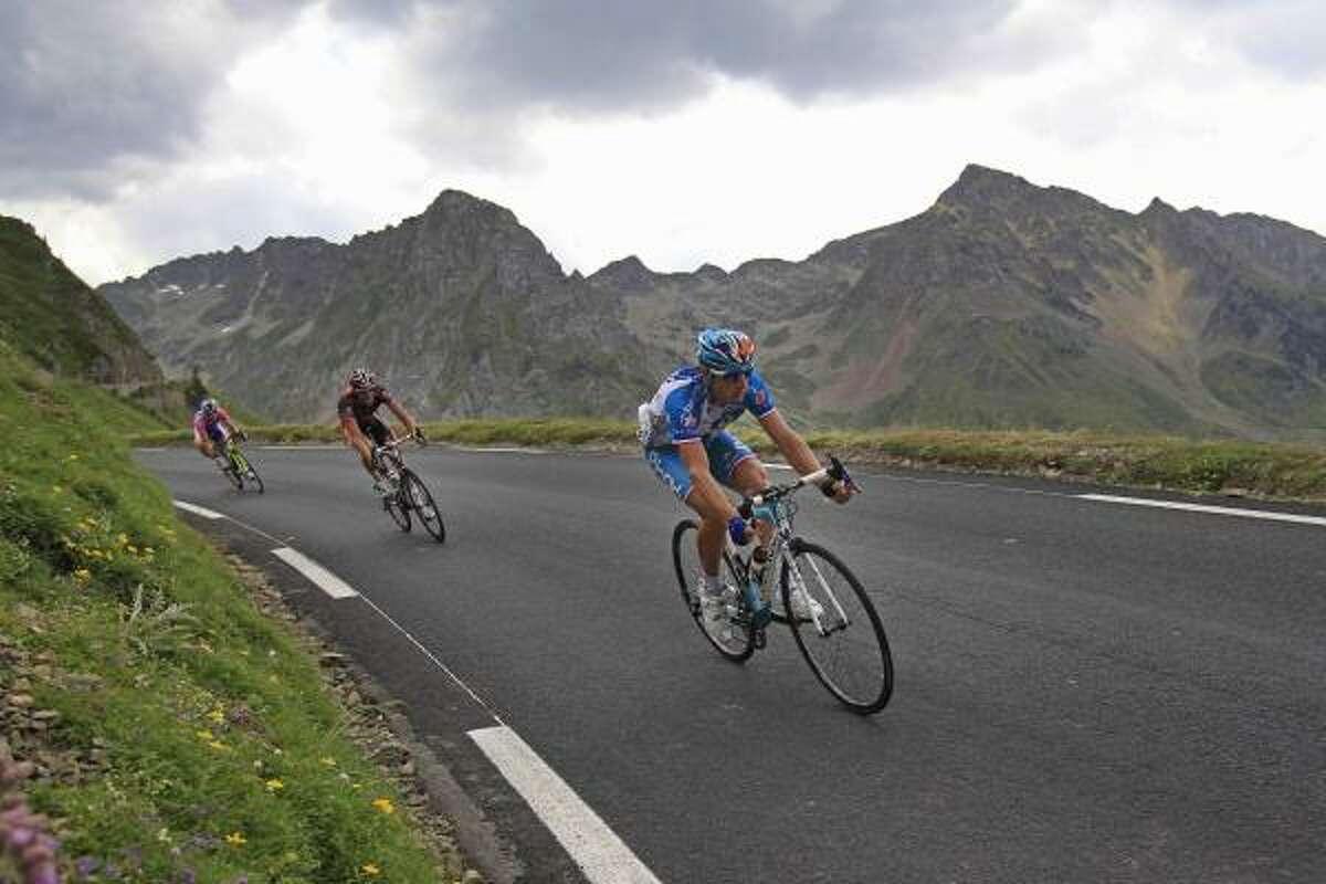 Stage winner Pierrick Fedrigo of France, right, speeds down Tourmalet Pass.