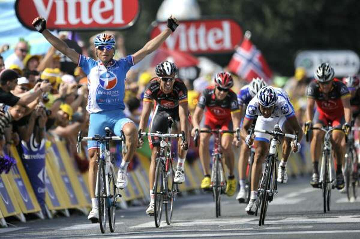 France's Pierrick Fedrigo celebrates on the finish line as he wins ahead of countryman Sandy Casar and Ruben Plaza and American Lance Armstrong.