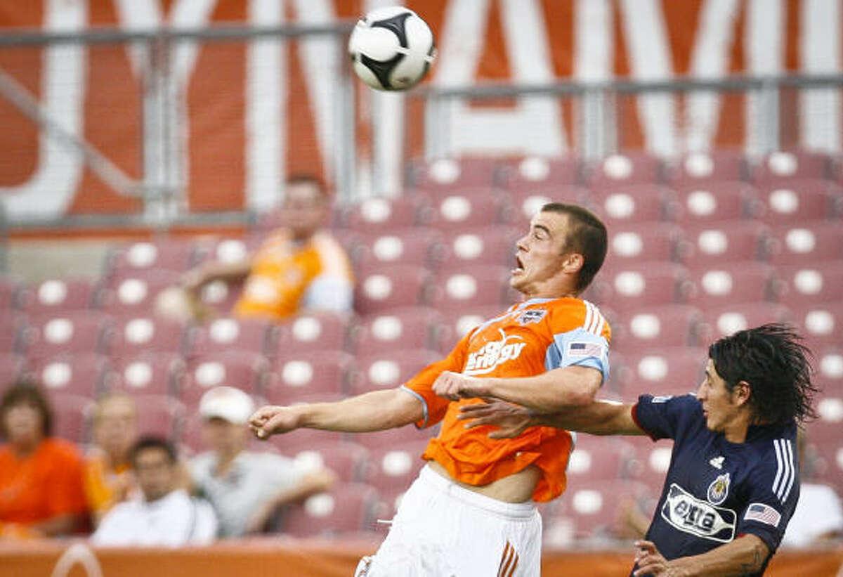 Dynamo forward Cam Weaver, left, battles against Chivas USA's Carlos Borja.